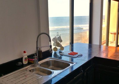 bouad_penthouse_kitchen_with_view_and_waves
