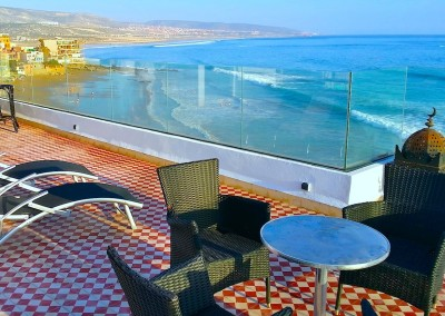 bouad_top_terrace_with_furniture_view_taghazout_surf_school_morocco_yoga_retreats-min